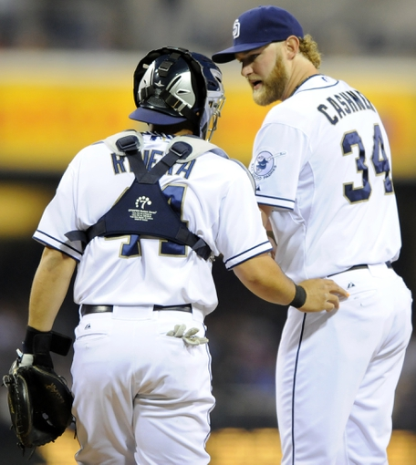 May 2, 2014; San Diego, CA, USA; San Diego Padres catcher Rene Rivera (44) talks with starting pitcher Andrew Cashner (34) against the Arizona Diamondbacks at Petco Park. Mandatory Credit: Christopher Hanewinckel-USA TODAY Sports