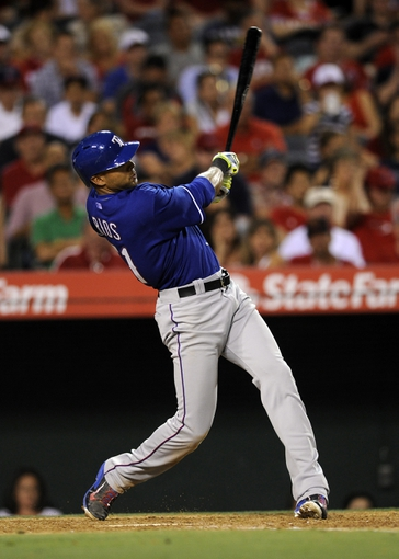 May 2, 2014; Anaheim, CA, USA; Texas Rangers right fielder Alex Rios (51) hits a two-run home run against the Los Angeles Angels during the sixth inning at Angel Stadium of Anaheim. Mandatory Credit: Kelvin Kuo-USA TODAY Sports
