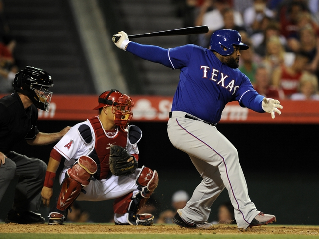 May 2, 2014; Anaheim, CA, USA; Texas Rangers first baseman Prince Fielder (84) hits an infield single against the Los Angeles Angels during the sixth inning at Angel Stadium of Anaheim. Mandatory Credit: Kelvin Kuo-USA TODAY Sports