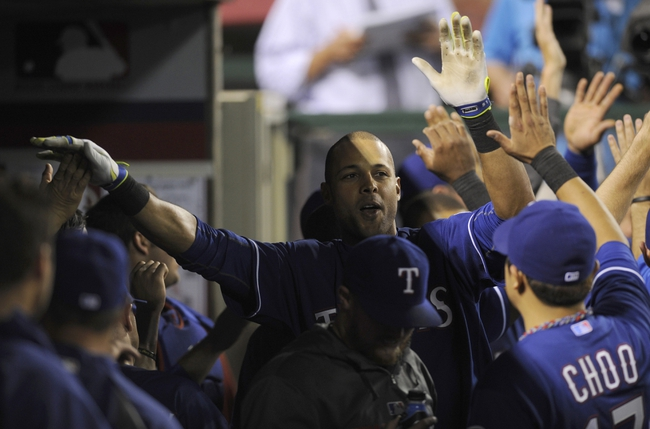 May 2, 2014; Anaheim, CA, USA; Texas Rangers right fielder Alex Rios (right) celebrates with his team in the dugout after hitting a two-run home run against the Los Angeles Angels during the sixth inning at Angel Stadium of Anaheim. Mandatory Credit: Kelvin Kuo-USA TODAY Sports