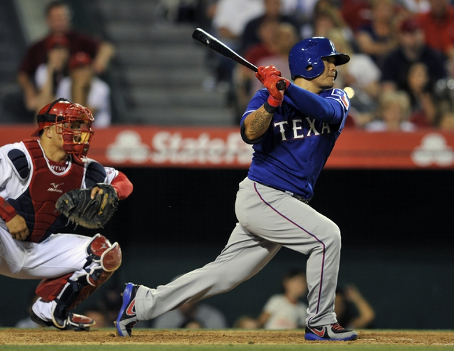 May 2, 2014; Anaheim, CA, USA; Texas Rangers left fielder Shin-Soo Choo (17) hits a RBI single against the Los Angeles Angels during the seventh inning at Angel Stadium of Anaheim. Mandatory Credit: Kelvin Kuo-USA TODAY Sports