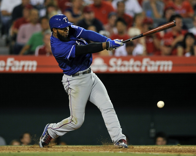 May 2, 2014; Anaheim, CA, USA; Texas Rangers shortstop Elvis Andrus (1) hits to fielders choice against the Los Angeles Angels during the seventh inning at Angel Stadium of Anaheim. Mandatory Credit: Kelvin Kuo-USA TODAY Sports