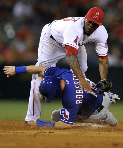 May 2, 2014; Anaheim, CA, USA; Los Angeles Angels second baseman Howie Kendrick (47) attempts to avoid Texas Rangers Daniel Robertson (19) after he throws to first after forcing out on a double play during the ninth inning at Angel Stadium of Anaheim. The Texas Rangers defeated the Los Angeles Angels 5-2. Mandatory Credit: Kelvin Kuo-USA TODAY Sports