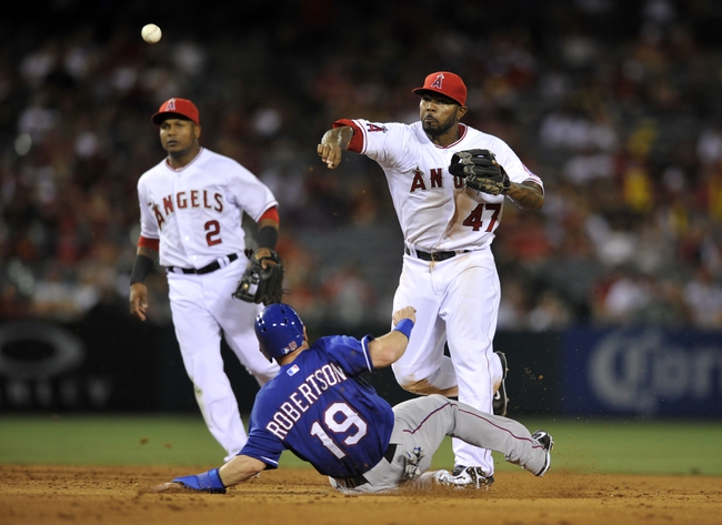 May 2, 2014; Anaheim, CA, USA; Los Angeles Angels second baseman Howie Kendrick (47) throws to first after forcing out Texas Rangers Daniel Robertson (19) on a double play during the ninth inning at Angel Stadium of Anaheim. The Texas Rangers defeated the Los Angeles Angels 5-2. Mandatory Credit: Kelvin Kuo-USA TODAY Sports