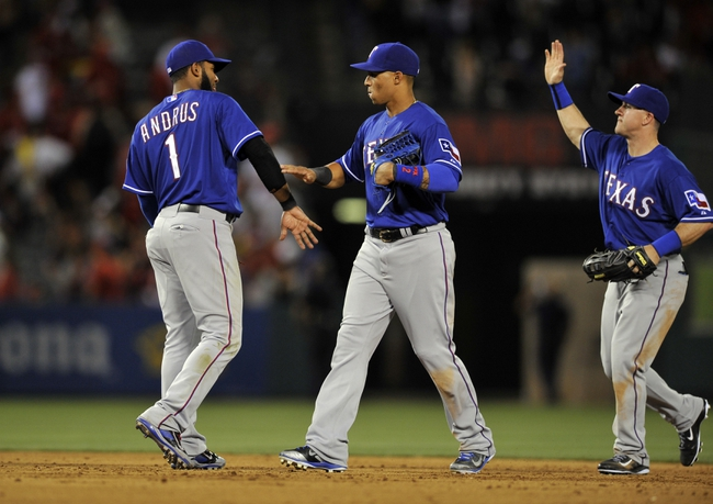 May 2, 2014; Anaheim, CA, USA; Texas Rangers shortstop Elvis Andrus (left) celebrates with Texas Rangers center fielder Leonys Martin (right) after the game against the Los Angeles Angels at Angel Stadium of Anaheim. The Texas Rangers defeated the Los Angeles Angels 5-2. Mandatory Credit: Kelvin Kuo-USA TODAY Sports
