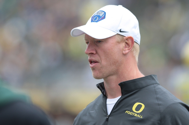 May 3, 2014; Eugene, OR, USA; Oregon Ducks offensive coach Scott Frost walks on to the field at Autzen Stadium. Mandatory Credit: Scott Olmos-USA TODAY Sports