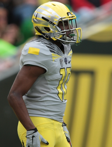 May 3, 2014; Eugene, OR, USA; Oregon Ducks wide receiver Johnathan Loyd (10) waits down field for a kick at Autzen Stadium. Mandatory Credit: Scott Olmos-USA TODAY Sports