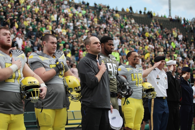 May 3, 2014; Eugene, OR, USA; Oregon Ducks head coach Mark Hilfrich stands with US military personnel before the Spring Game at Autzen Stadium. Mandatory Credit: Scott Olmos-USA TODAY Sports