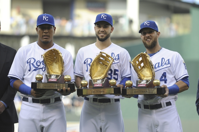 May 3, 2014; Kansas City, MO, USA;  Kansas City Royals catcher Salvador Perez (13) and first baseman Eric Hosmer (35) and left fielder Alex Gordon (4) hold their Golden Glove awards before the game against the Detroit Tigers at Kauffman Stadium. Detroit won 9-2. Mandatory Credit: John Rieger-USA TODAY Sports