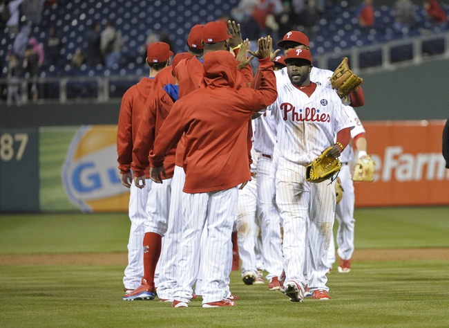May 3, 2014; Philadelphia, PA, USA; Philadelphia Phillies center fielder Tony Gwynn (19) celebrates win with his teammates against the Washington Nationals at Citizens Bank Park. The Phillies defeated the Nationals, 7-2. Mandatory Credit: Eric Hartline-USA TODAY Sports