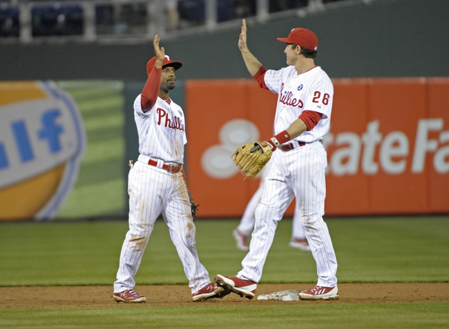 May 3, 2014; Philadelphia, PA, USA; Philadelphia Phillies shortstop Jimmy Rollins (11) and second baseman Chase Utley (26) celebrate win against the Washington Nationals at Citizens Bank Park. The Phillies defeated the Nationals, 7-2. Mandatory Credit: Eric Hartline-USA TODAY Sports