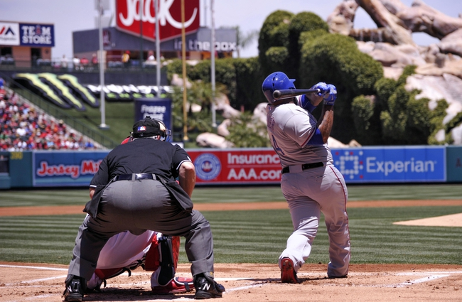May 4, 2014; Anaheim, CA, USA; Texas Rangers first baseman Prince Fielder (84) doubles in the 1st inning driving in a run against the Los Angeles Angels at Angel Stadium of Anaheim. Mandatory Credit: Robert Hanashiro-USA TODAY Sports