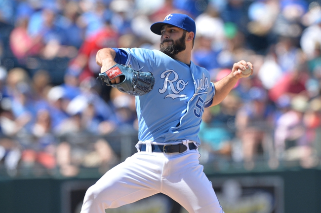 May 4, 2014; Kansas City, MO, USA; Kansas City Royals pitcher Tim Collins (55) delivers a pitch against the Detroit Tigers during the seventh inning at Kauffman Stadium. The Tigers beat the Royals 9-4. Mandatory Credit: Peter G. Aiken-USA TODAY Sports