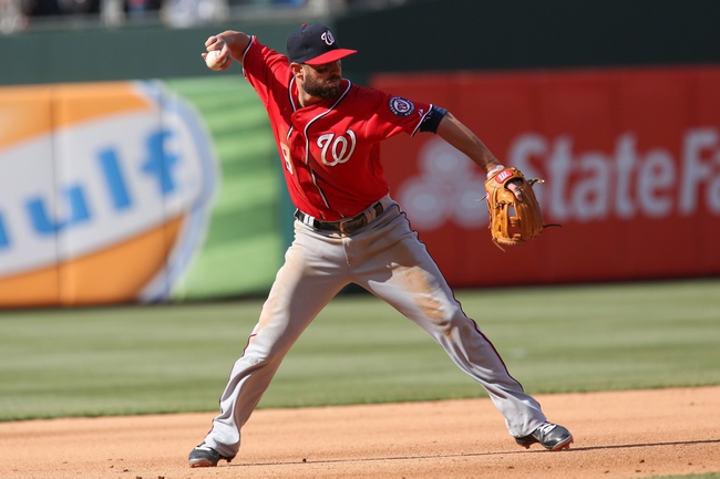 May 4, 2014; Philadelphia, PA, USA; Washington Nationals left fielder Kevin Frandsen (19) throws out Philadelphia Phillies right fielder John Mayberry Jr. (15) (not pictured) in the 5th inning at Citizens Bank Park. Mandatory Credit: Bill Streicher-USA TODAY Sports