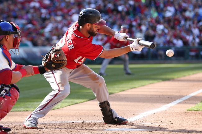 May 4, 2014; Philadelphia, PA, USA; Washington Nationals left fielder Kevin Frandsen (19) successfully moves center fielder Denard Span (2) (not pictured)  with a sacrifice bunt in the 8th inning of a game against the Philadelphia Phillies at Citizens Bank Park.  The Phillies defeated the Nationals 1-0. Mandatory Credit: Bill Streicher-USA TODAY Sports