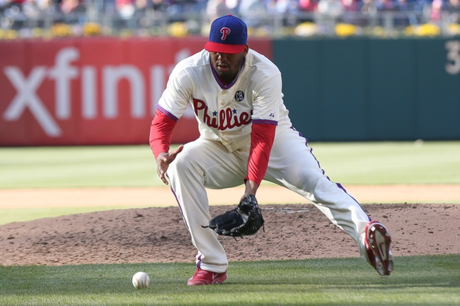 May 4, 2014; Philadelphia, PA, USA; Philadelphia Phillies starting pitcher Roberto Hernandez (27) fields a ground ball in the 8th inning of a game against the Washington Nationals at Citizens Bank Park.  The Phillies defeated the Nationals 1-0. Mandatory Credit: Bill Streicher-USA TODAY Sports