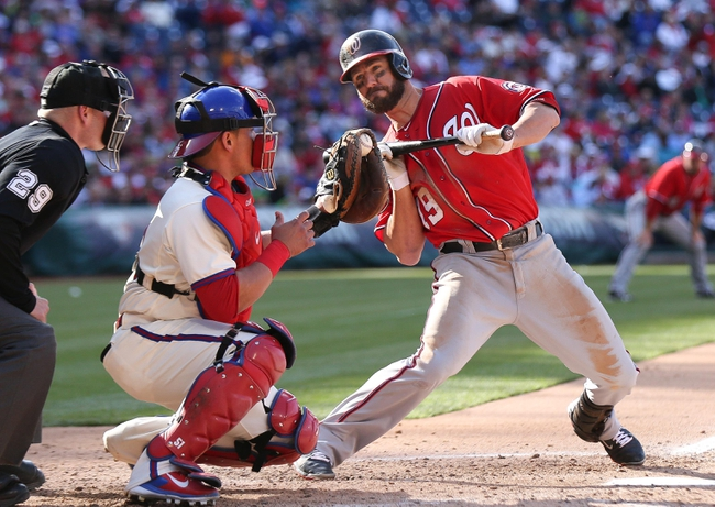 May 4, 2014; Philadelphia, PA, USA; Washington Nationals left fielder Kevin Frandsen (19) pulls back from a bunt attempt in front of Philadelphia Phillies catcher Carlos Ruiz (51) at Citizens Bank Park.  The Phillies defeated the Nationals 1-0. Mandatory Credit: Bill Streicher-USA TODAY Sports