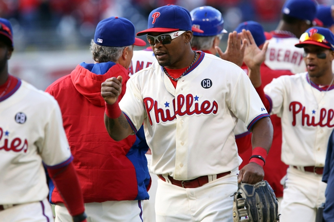 May 4, 2014; Philadelphia, PA, USA; Philadelphia Phillies right fielder Marlon Byrd (3) congratulates team mates at the conclusion of the game against the Washington Nationals at Citizens Bank Park. The Phillies defeated the Nationals 1-0. Mandatory Credit: Bill Streicher-USA TODAY Sports