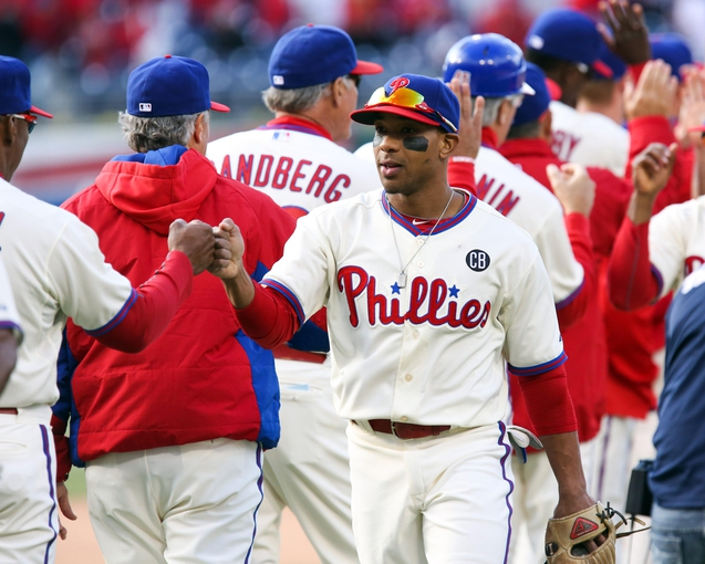 May 4, 2014; Philadelphia, PA, USA; Philadelphia Phillies center fielder Ben Revere (2) congratulates team mates at the conclusion of the game against the Washington Nationals at Citizens Bank Park. The Phillies defeated the Nationals 1-0. Mandatory Credit: Bill Streicher-USA TODAY Sports