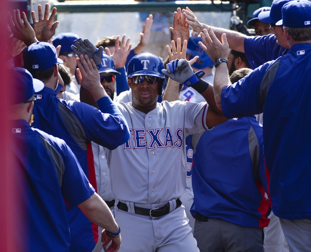 May 4, 2014; Anaheim, CA, USA; Texas Rangers third baseman Adrian Beltre (29) gets high-fives from teammates after scoring in the 9th inning against the Los Angeles Angels at Angel Stadium of Anaheim. The Rangers won 14-3. Mandatory Credit: Robert Hanashiro-USA TODAY Sports