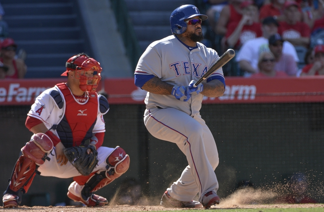 May 4, 2014; Anaheim, CA, USA; Texas Rangers first baseman Prince Fielder (84) hits a single  in the 8th inning against the Los Angeles Angels at Angel Stadium of Anaheim. Fielder had three hits in the game and the Rangers won 14-3. Mandatory Credit: Robert Hanashiro-USA TODAY Sports