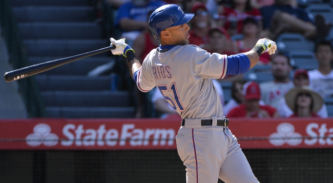 May 4, 2014; Anaheim, CA, USA; Texas Rangers right fielder Alex Rios (51) at the plate during the 8th inning the the Rangers 14-3 win over the Los Angeles Angels at Angel Stadium of Anaheim. Mandatory Credit: Robert Hanashiro-USA TODAY Sports