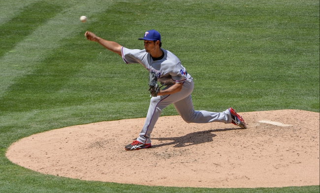 May 4, 2014; Anaheim, CA, USA; Texas Rangers starting pitcher Yu Darvish (11) throws in the 4th inning against the Los Angeles Angels at Angel Stadium of Anaheim. Mandatory Credit: Robert Hanashiro-USA TODAY Sports