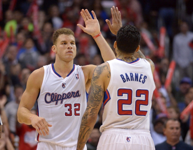 Feb 12, 2014; Los Angeles, CA, USA; Los Angeles Clippers forwards Blake Griffin (32) and Matt Barnes (22) exchange high fives in the fourth quarter against the Portland Trail Blazers at Staples Center. The Clippers defeated the Trail Blazers 122-117. Mandatory Credit: Kirby Lee-USA TODAY Sports