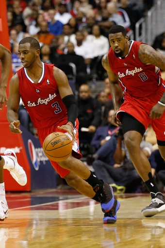 Dec 14, 2013; Washington, DC, USA; Los Angeles Clippers point guard Chris Paul (3) dribbles the ball in front of Clippers center DeAndre Jordan (6) against the Washington Wizards at Verizon Center. Mandatory Credit: Geoff Burke-USA TODAY Sports