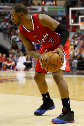 Dec 14, 2013; Washington, DC, USA; Los Angeles Clippers point guard Chris Paul (3) holds the ball against the Washington Wizards at Verizon Center. Mandatory Credit: Geoff Burke-USA TODAY Sports