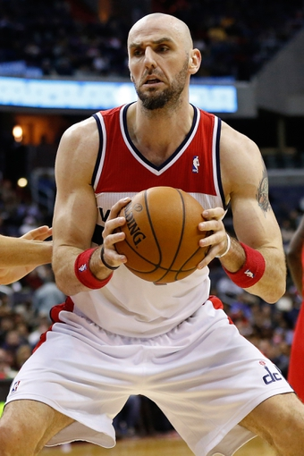 Dec 14, 2013; Washington, DC, USA; Washington Wizards center Marcin Gortat (4) holds the ball against the Los Angeles Clippers at Verizon Center. Mandatory Credit: Geoff Burke-USA TODAY Sports