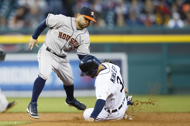 May 5, 2014; Detroit, MI, USA; Detroit Tigers second baseman Ian Kinsler (3) slides into second as Houston Astros second baseman Jose Altuve (27) applies the tag in the fifth inning at Comerica Park. Kinsler would be called safe but the call would be overturned after a video review. Mandatory Credit: Rick Osentoski-USA TODAY Sports