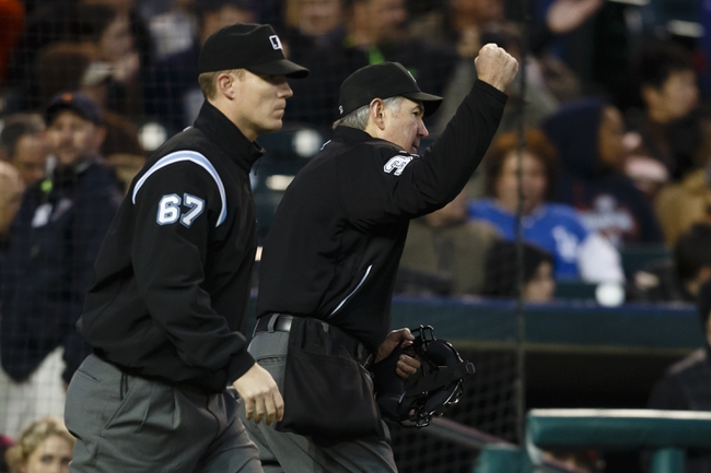 May 5, 2014; Detroit, MI, USA; Umpire Mike Winters (right) overturns a call by umpire Seth Buckminster (67) of Detroit Tigers second baseman Ian Kinsler safe at second after a video review in the fifth inning against the Houston Astros at Comerica Park. Mandatory Credit: Rick Osentoski-USA TODAY Sports