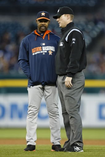 May 5, 2014; Detroit, MI, USA; Houston Astros manager Bo Porter (16) asks second base umpire Seth Buckminster to review his call at second base in the fifth inning against the Detroit Tigers at Comerica Park. Mandatory Credit: Rick Osentoski-USA TODAY Sports