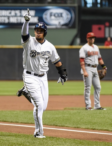 May 5, 2014; Milwaukee, WI, USA;   Milwaukee Brewers center fielder Carlos Gomez (27) reacts as he runs the bases after hitting a solo home run in the first inning against the Arizona Diamondbacks at Miller Park. Mandatory Credit: Benny Sieu-USA TODAY Sports