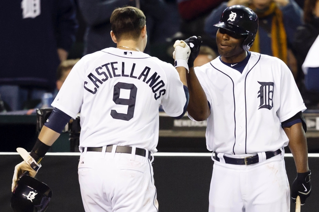 May 5, 2014; Detroit, MI, USA; Detroit Tigers third baseman Nick Castellanos (9) receives congratulations from right atielder Torii Hunter (48) after scoring in the seventh inning against the Houston Astros at Comerica Park. Mandatory Credit: Rick Osentoski-USA TODAY Sports