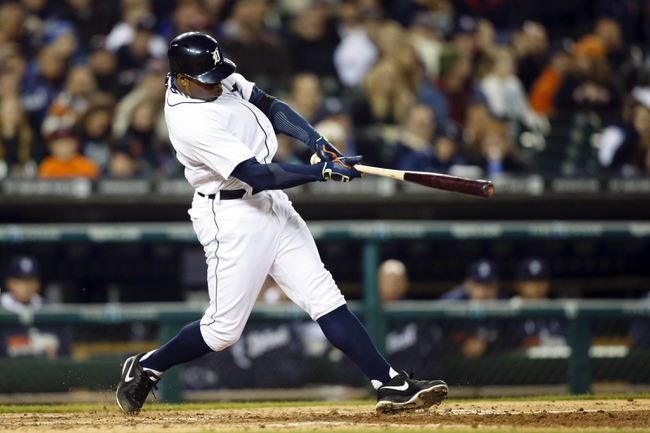 May 5, 2014; Detroit, MI, USA; Detroit Tigers left fielder Rajai Davis (20) hits an RBI single in the seventh inning against the Houston Astros at Comerica Park. Mandatory Credit: Rick Osentoski-USA TODAY Sports