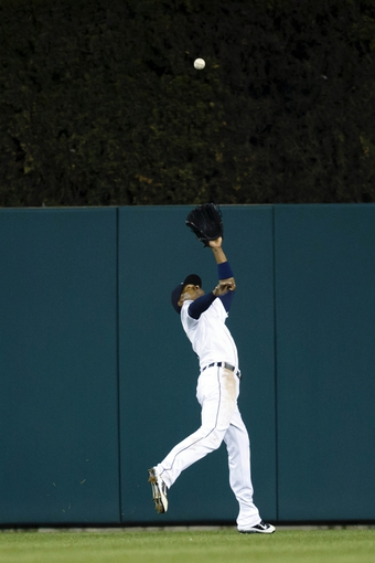 May 5, 2014; Detroit, MI, USA; Detroit Tigers center fielder Austin Jackson (14) makes a catch for an out in the seventh inning against the Houston Astros at Comerica Park. Mandatory Credit: Rick Osentoski-USA TODAY Sports