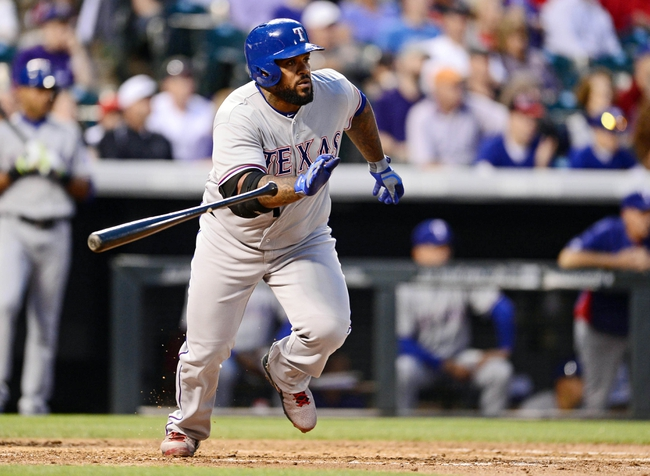 May 5, 2014; Denver, CO, USA; Texas Rangers first baseman Prince Fielder (84) hits a single in the fourth inning against the Colorado Rockies at Coors Field. Mandatory Credit: Ron Chenoy-USA TODAY Sports