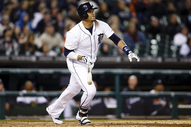 May 5, 2014; Detroit, MI, USA; Detroit Tigers designated hitter Victor Martinez (41) hits a home run in the eighth inning against the Houston Astros at Comerica Park. Detroit won 2-0. Mandatory Credit: Rick Osentoski-USA TODAY Sports