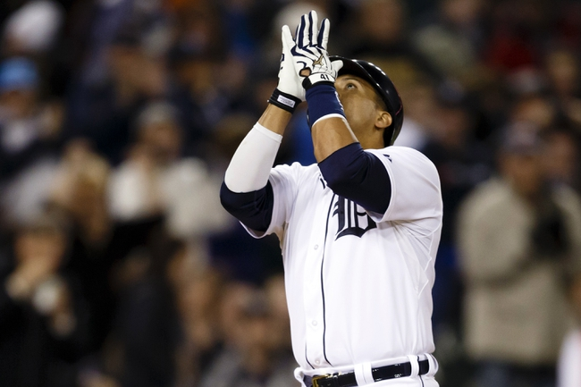 May 5, 2014; Detroit, MI, USA; Detroit Tigers designated hitter Victor Martinez (41) looks to the sky as he crosses home plate after he hits a home run in the eighth inning against the Houston Astros at Comerica Park. Detroit won 2-0. Mandatory Credit: Rick Osentoski-USA TODAY Sports