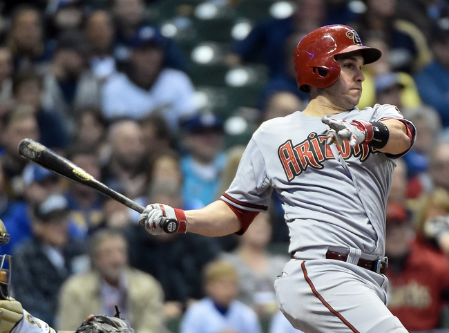 May 5, 2014; Milwaukee, WI, USA;  Arizona Diamondbacks catcher Miguel Montero (26) hits a single to drive in a run in the third inning against the Milwaukee Brewers at Miller Park. Mandatory Credit: Benny Sieu-USA TODAY Sports