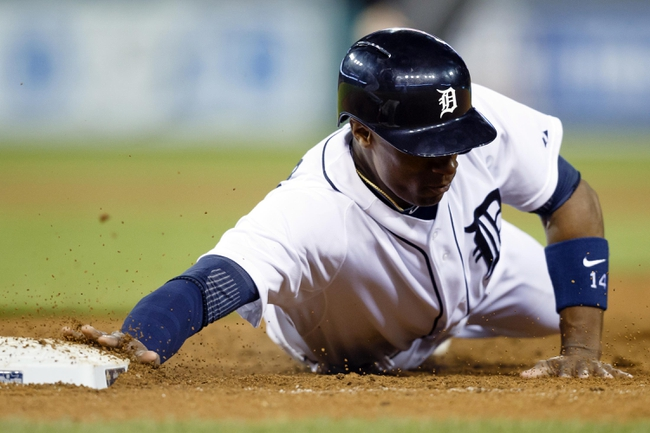 May 5, 2014; Detroit, MI, USA; Detroit Tigers center fielder Austin Jackson (14) dives back to first base safe in the eighth inning against the Houston Astros at Comerica Park. Detroit won 2-0. Mandatory Credit: Rick Osentoski-USA TODAY Sports