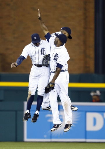 May 5, 2014; Detroit, MI, USA; Detroit Tigers left fielder Rajai Davis (left) center fielder Austin Jackson (center) and right fielder Torii Hunter (right) celebrates after the game against the Houston Astros at Comerica Park. Detroit won 2-0. Mandatory Credit: Rick Osentoski-USA TODAY Sports