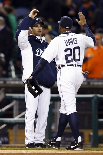 May 5, 2014; Detroit, MI, USA; Detroit Tigers left fielder Rajai Davis (20) high fives with manager Brad Ausmus (7) after the game against the Houston Astros at Comerica Park. Detroit won 2-0. Mandatory Credit: Rick Osentoski-USA TODAY Sports