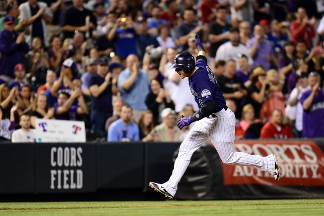May 5, 2014; Denver, CO, USA; Colorado Rockies shortstop Troy Tulowitzki (2) reacts to his home run in the fifth inning against the Texas Rangers at Coors Field. Mandatory Credit: Ron Chenoy-USA TODAY Sports