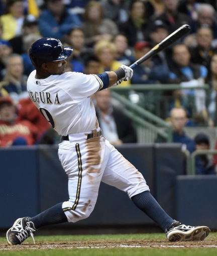 May 5, 2014; Milwaukee, WI, USA;  Milwaukee Brewers shortstop Jean Segura (9) hits a 2-run homer in the sixth inning against the Arizona Diamondbacks at Miller Park. Mandatory Credit: Benny Sieu-USA TODAY Sports