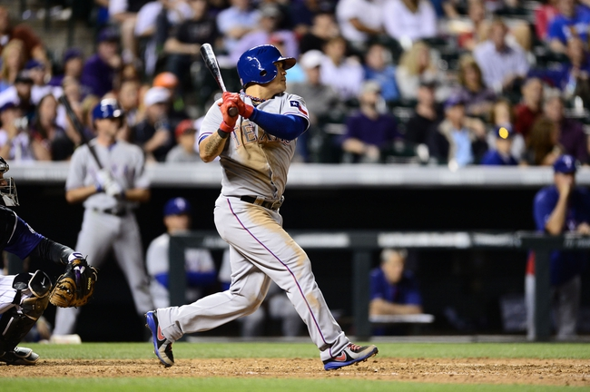 May 5, 2014; Denver, CO, USA; Texas Rangers left fielder Shin-Soo Choo (17) singles in the eighth inning against the Colorado Rockies at Coors Field. Mandatory Credit: Ron Chenoy-USA TODAY Sports
