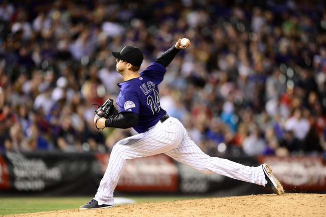 May 5, 2014; Denver, CO, USA; Colorado Rockies starting pitcher Jordan Lyles (24) throws in the eighth inning against the Texas Rangers at Coors Field. Mandatory Credit: Ron Chenoy-USA TODAY Sports