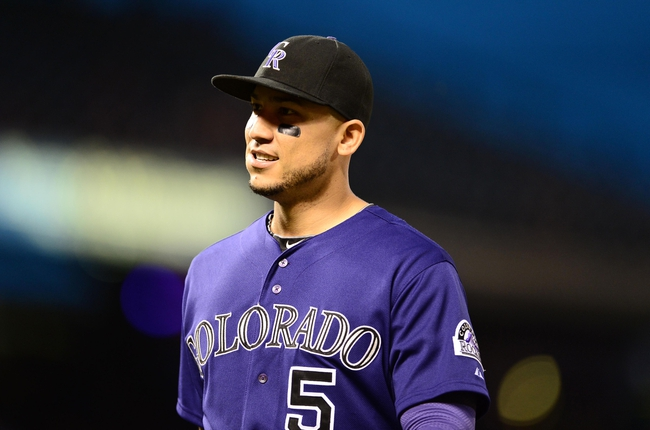 May 5, 2014; Denver, CO, USA; Colorado Rockies left fielder Carlos Gonzalez (5) during the fifth inning against the Texas Rangers at Coors Field. Mandatory Credit: Ron Chenoy-USA TODAY Sports